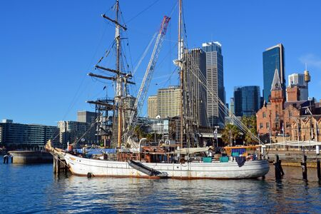 circular: Sydney, Australia - July 17, 2014: Historic sailing ship moored at Circular Quay with the Rocks  CBD buildings in the background.