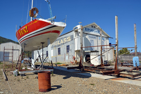chandler: Picton, New Zealand - October 09, 2015: Yacht being repaired at a Shipyard in Waikawa Marina, Picton, New Zealand.