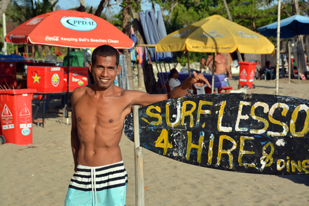 legian: Bali, Indonesia - September13, 2015: Young male Surfing Instructor on the Beach at Legian, Bali