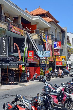 seminyak: Bali, Indonesia - September 14, 2015: Colourful shops, resturants  scooters on the tiny main street in Seminyak.