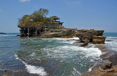 Famous Tanah Lot Hindu Temple isolated on Rocks by the Incoming Tide, Bali Indonesia