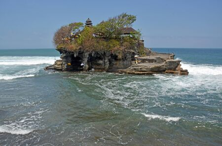 Famous Hindu Tanah Lot Temple appears to be sailing away under its own steam, Bali Indonesia