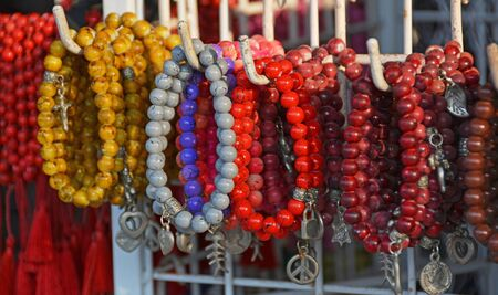Colourful red, yellow, grey, brown and purple  Coral beads and bracelets for sale in a Legian Shop, Bali Indonesia.