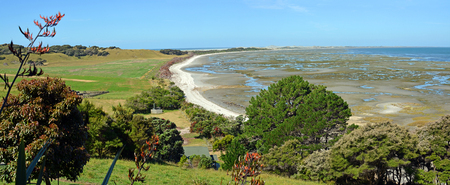 south pacific ocean: Farewell Spit panorama at low tide located at the very top of the South Island, New Zealand. Photo taken from the restaurant at Puponga.This is where the Tasman Sea meets the Pacific Ocean.