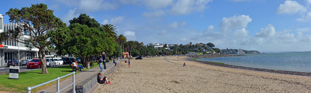 new zealand beach: Auckland, New Zealand - May 22, 2016: Panoramic view of St Helliers Beach and people.  Auckland, New Zealand