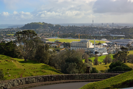 alexandra: Auckland city landscape on a stormy winter day viewed from One Tree hill. In the foreground is Alexandra park and Epsom. In the background is Mount Eden and downtown Auckland the The Skytower.