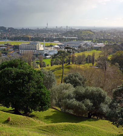 eden: Auckland city landscape on a stormy winter day viewed from One Tree hill. In the foreground is Alexandra park and Epsom. In the background is Mount Eden and downtown Auckland the The Skytower.