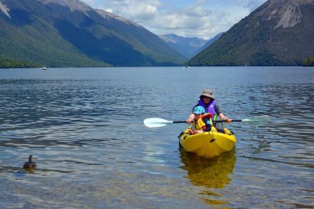nelson: Rotoiti, New Zealand - December 26, 2016:Man and child kayaking on Lake Rotoiti in Summer.