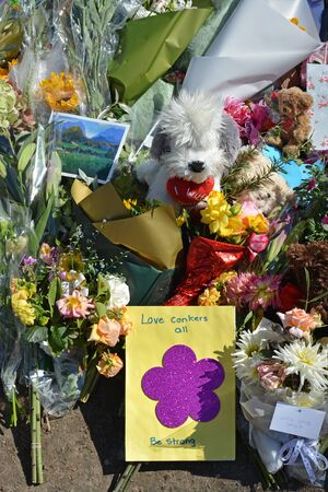 Christchurch, New Zealand - March 19, 2019; Floral tribute & Love Conkers All message of Love from Kiwis to the 50 people shot and killed at two Mosques on March 15, 2019.