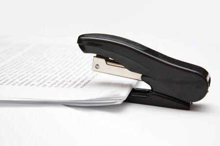 fasten: stepler fasten paper on white background
