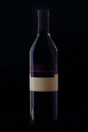The wine bottle on the dark background. photo