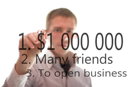 The businessmen writes about bisiness on the glass  Isolated on the white background  photo