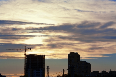 Construction Site on the sky on sunset background photo