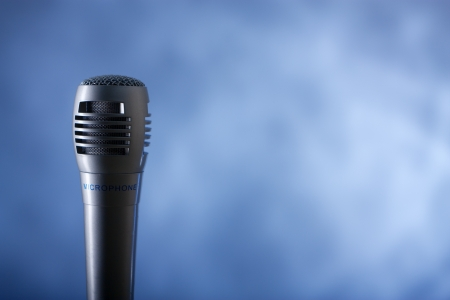 the single microphone on the blue background photo