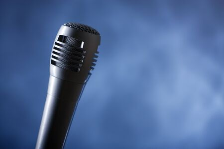 the single microphone on the dark background photo