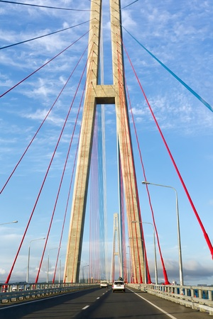 The pylons of the cable-stayed bridge against the blue sky Stock Photo