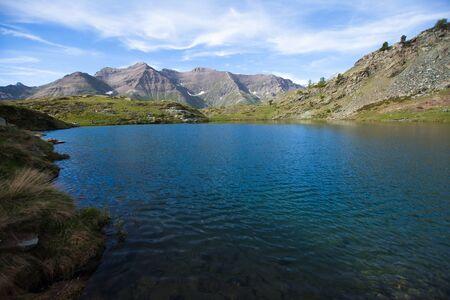 aosta: Clear blue mountain lake Lago di Loie in summer, Lillaz, Cogne, Aosta valley, Italy