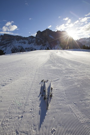 raiser: Skis on the skiing slope in Dolomites, Italy Stock Photo