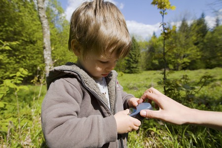 navigator: Caucasian toddler holding gps navigator in the mountains