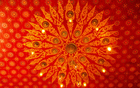 the traditional painting on the ceiling in Thai temple Stock Photo - 24253127