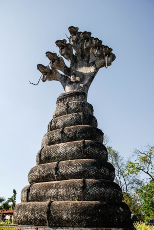 Buddha Meditation has seven headed serpent spread to cover  photo