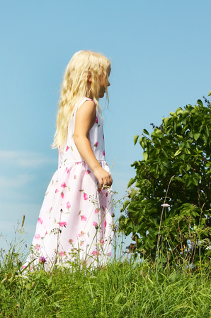 lillac: Little blond girl walking on the grass