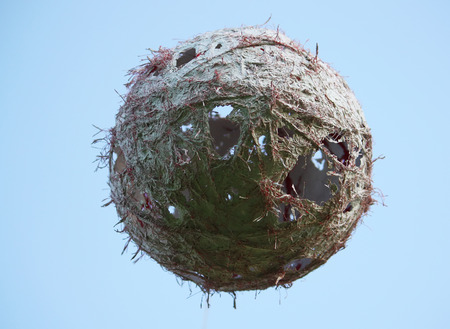 holed: Homemade decor.A large ball made of plaster and thread