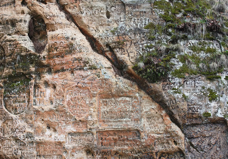 gauja: Old graffiti in the Gautmanis Cave,  sandstone rock of the Gauja river bank, Sigulda, Latvia Stock Photo