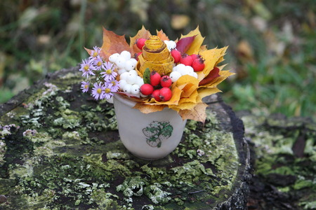 Autumn bouquet of yellow maple leaves and snowberries