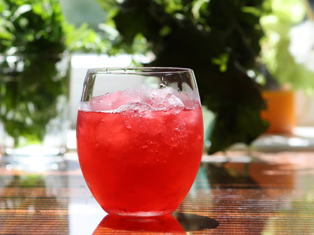 fruit of the spirit: Refreshing cold pink cocktail in a glass with ice
