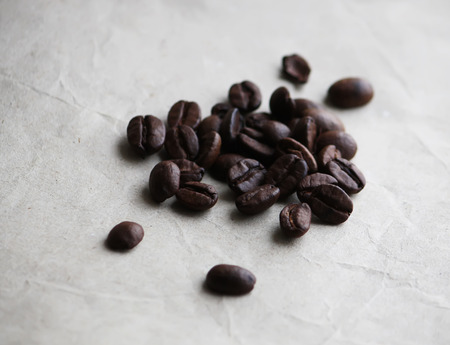 colombian food: Coffee beans on old crumpled craft paper texture