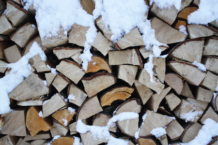 firewood background: Firewood background - chopped firewood on a stack