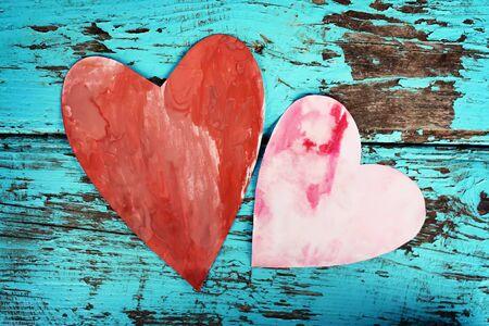 Decorative white handmade heart on wooden background. Stock Photo