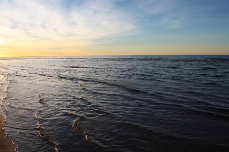 Sea water with small waves in Jurmala, Latvia. Coast of Baltic sea.