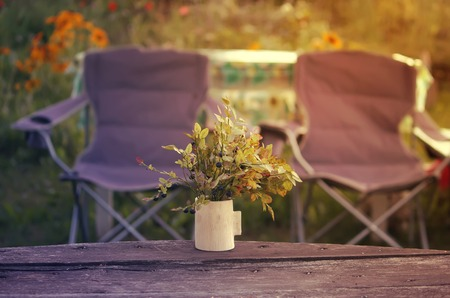 patio chairs: Two patio chairs on nature background outdoors Stock Photo
