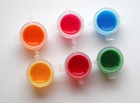 Watercolor bright liquid paints on white background Stock Photo