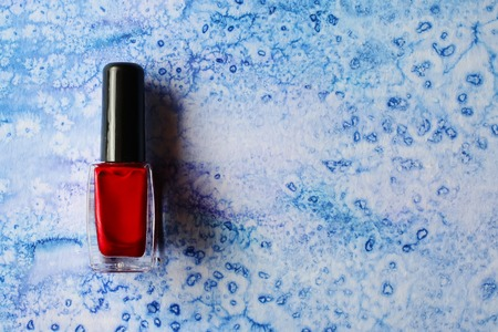 nail polish bottle: Red nail polish bottle on watercolor background