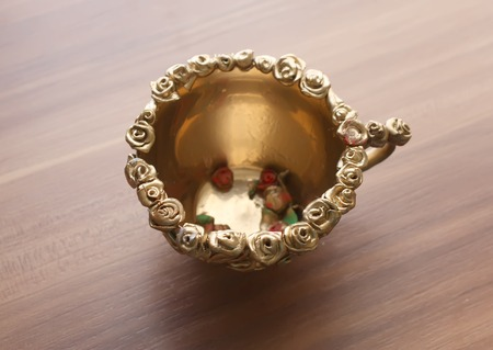 A cup with handmade decoration