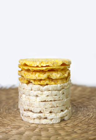 White rice crackers on whicker place mat background.