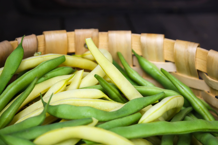 Fresh organic green beans in a basket close up. Stock Photo