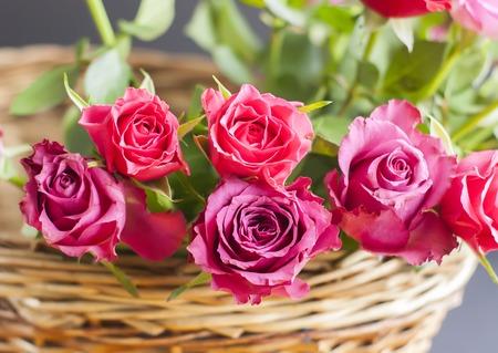 Beautiful bouquet of roses in a wicker basket.