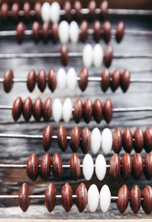 Vintage wooden abacus on old board surface. Stock fotó