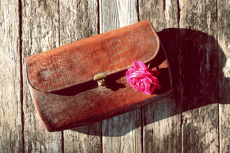 Old leather vintage reticule bag with rose.