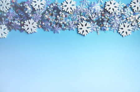 Christmas and New Year decorative  with small glitter stars and white snowflakes.