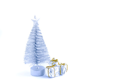 Decorative Christmas tree and gift boxes on fluffy snow background. Reklamní fotografie