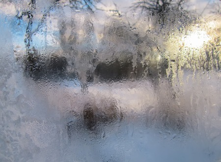 Frozen window glass. Winter nature background.