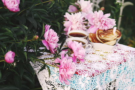 Tea in country style in summer garden in the village.