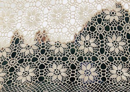 White crocheted handmade vintage tablecloth on nature  outdoors 版權商用圖片
