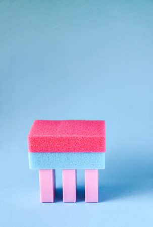 Colorful washcloths and bars of soap on a soft blue background. Accessories for body care and hygiene. Stok Fotoğraf
