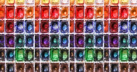 Watercolor bright paints cuvette background